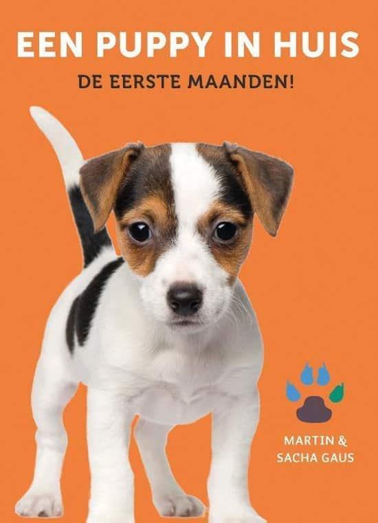 Boek puppy in huis